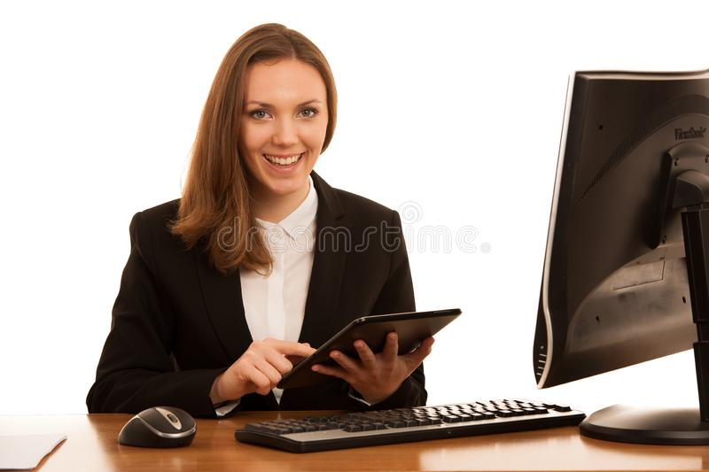 Corporate portrait of young beautiful caucasian business woman surfinh internet on tablet isolated over white background royalty free stock images