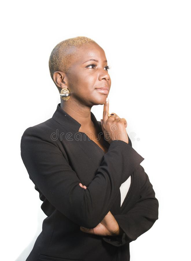 Young happy and attractive black afro American woman with modern hair style posing cheerful and cool smiling on isolated backgroun royalty free stock photography