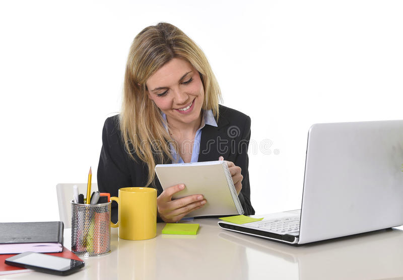 Corporate portrait young happy Caucasian blond business woman working using digital tablet pad at office royalty free stock images
