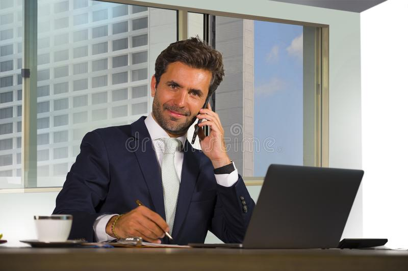 Corporate portrait of young happy handsome and attractive businessman working at computer desk in modern office at central busines. S financial district smiling stock photos