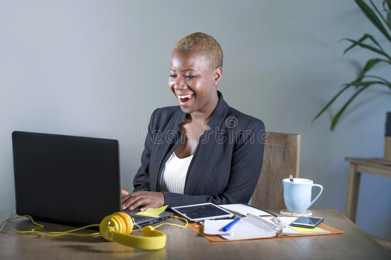 Corporate portrait of young happy and successful black afro American business woman working at modern office smiling cheerful havi royalty free stock photo