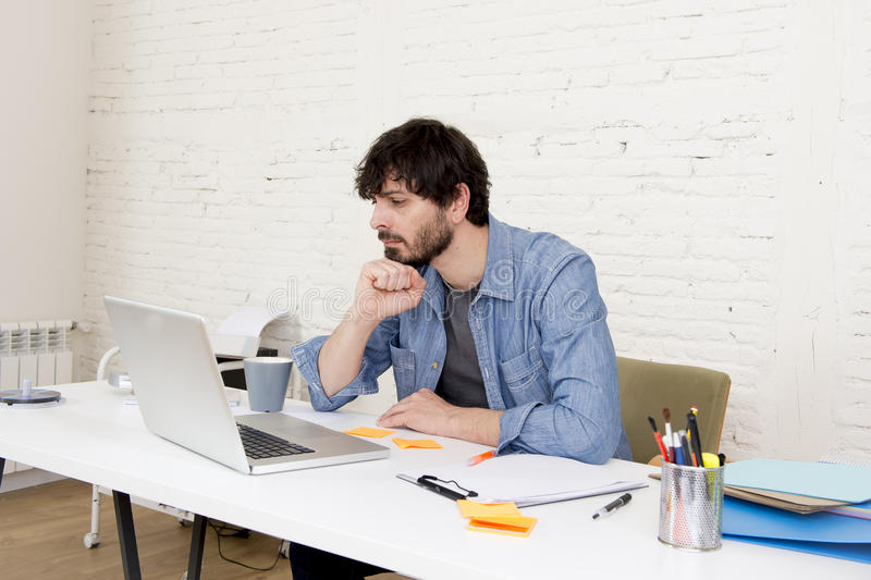 Corporate portrait young hispanic attractive hipster businessman working with computer modern home office. Corporate portrait of young hispanic attractive royalty free stock photos