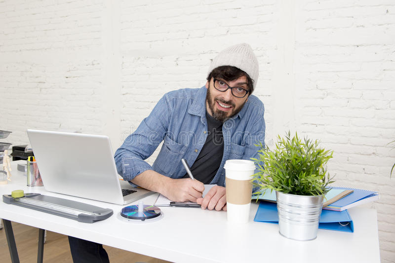 Corporate portrait of young hispanic attractive hipster businessman working at modern home office. Corporate portrait of young hispanic attractive hipster royalty free stock photo