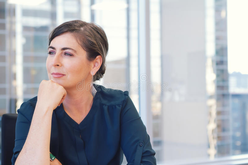Corporate professional business woman in city office with buildings in background royalty free stock photography
