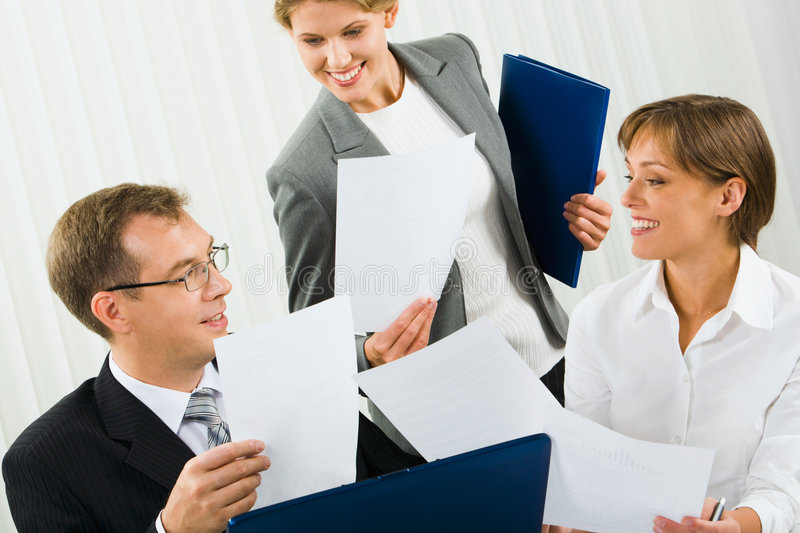 Corporate results. Confident businesswomen is showing research results to her boss in the office royalty free stock image