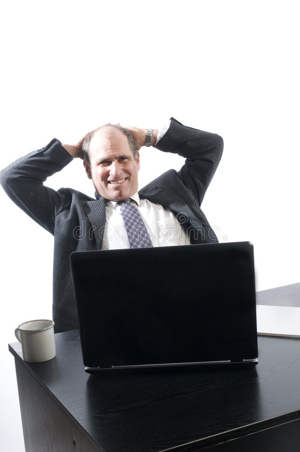 Corporate senior executive relaxing in office stock image