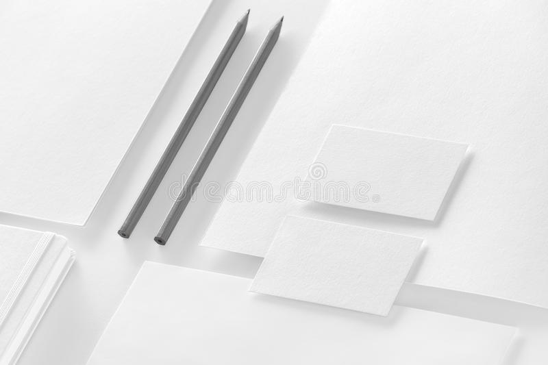 Corporate stationery set mockup. Presentation folders, letterhead, notepad, envelope and business cards at white textured paper b royalty free stock image