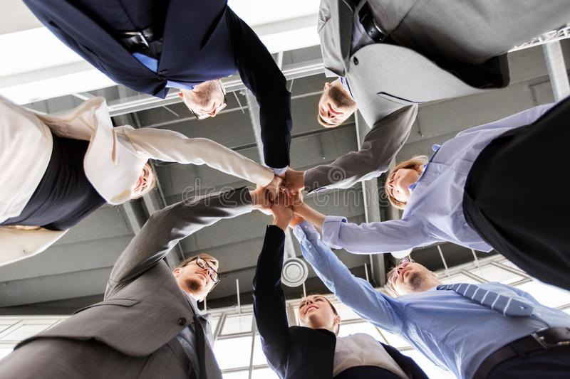 Business people making high five at office stock photo