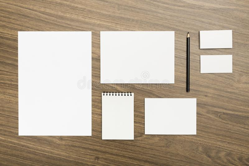 Corporate identity templates on wooden background stock photos