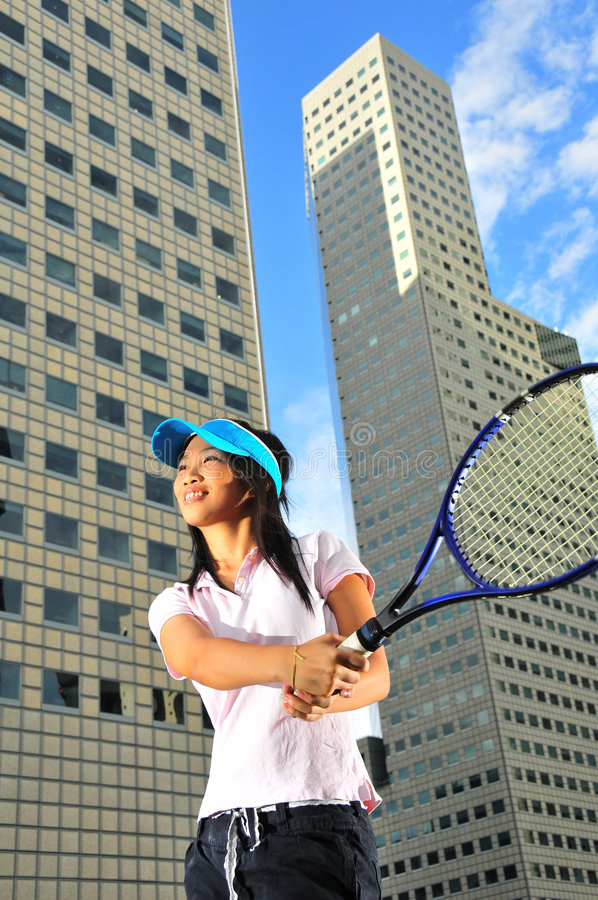 Corporate Tennis 3. Picture of Sports combined with the urban environment. Suitable for use on subject matters like healthy lifestyle, business is like sports royalty free stock photo
