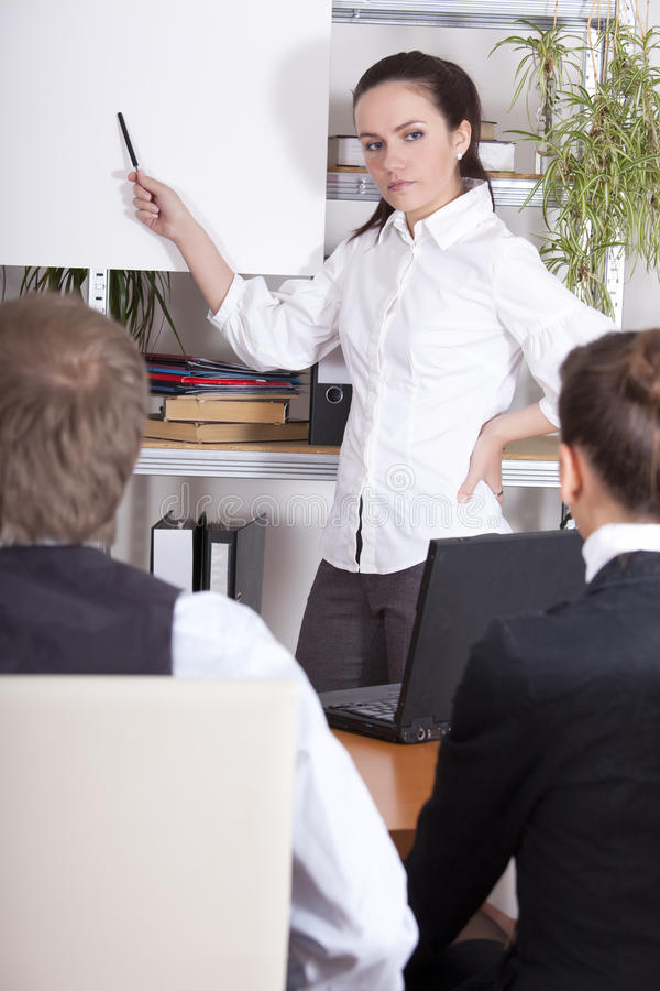 Corporate training. Man and woman receiving corporate training in an office royalty free stock photography