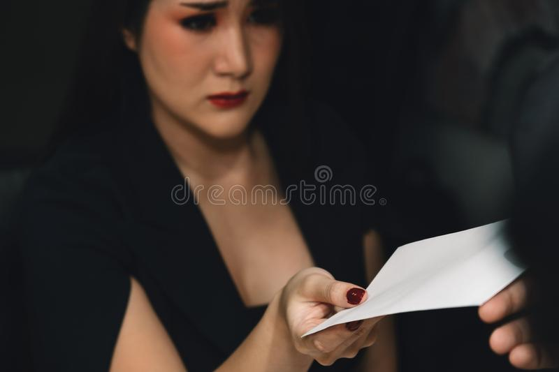 Corporate woman employee with sad face having notice of dismissal and getting fired from employer royalty free stock photos