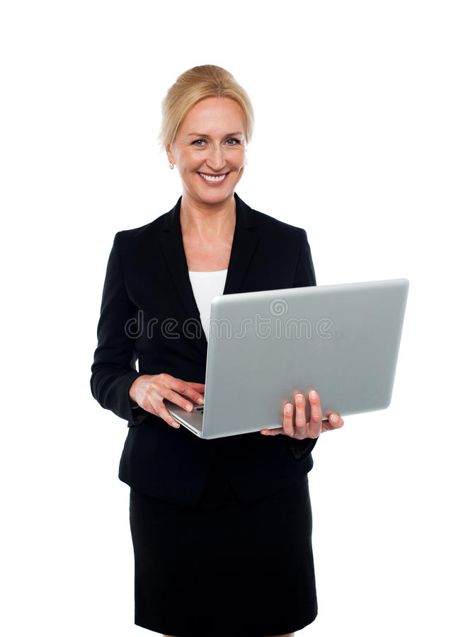 Download Corporate Woman Holding Laptop Stock Photo - Image of businesswoman, cheerful: 25997438