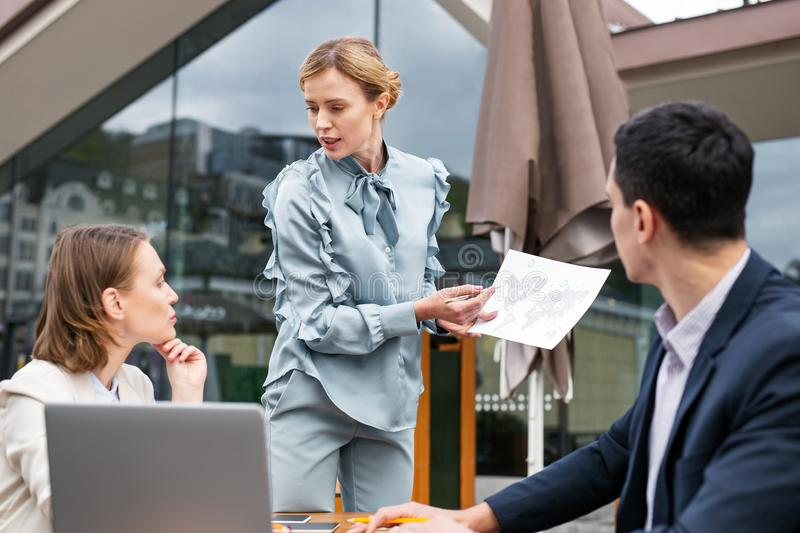 Corporate workers discussing future company expansion. Corporate workers. Corporate workers feeling involved in discussing future company expansion around the royalty free stock photo