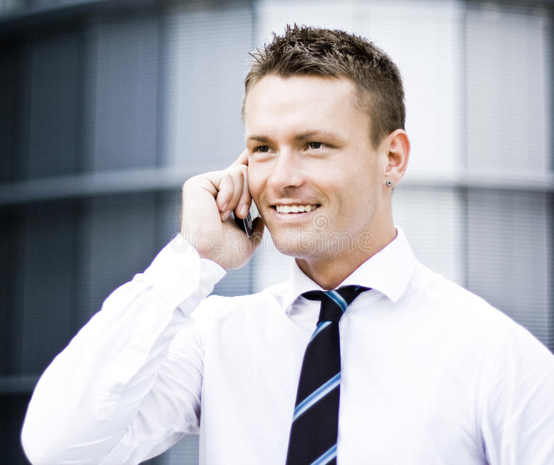 Corporate Young Man On Cellular Phone Stock Photos