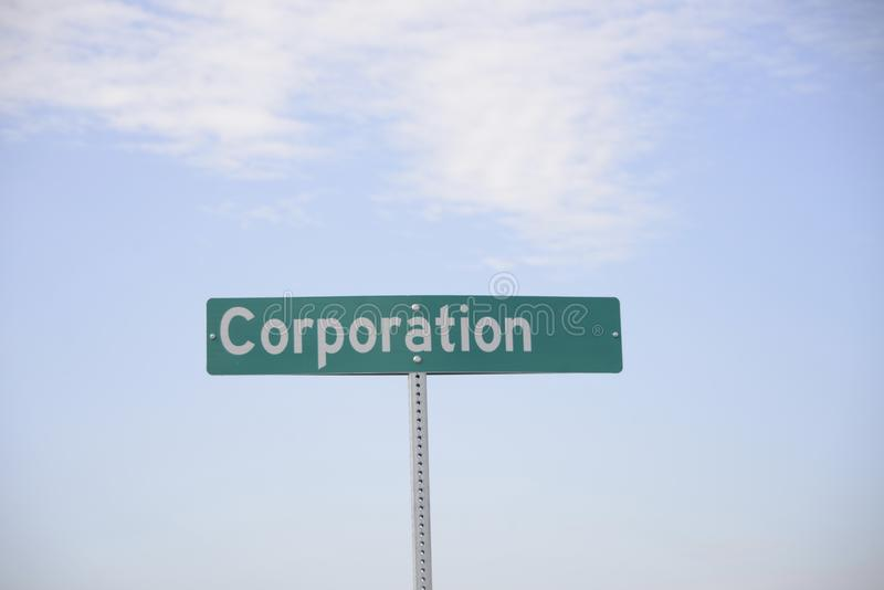 Corporation for Profit. A corporation is a company or group of people or an organisation authorized to act as a single entity and recognized as such in law stock image