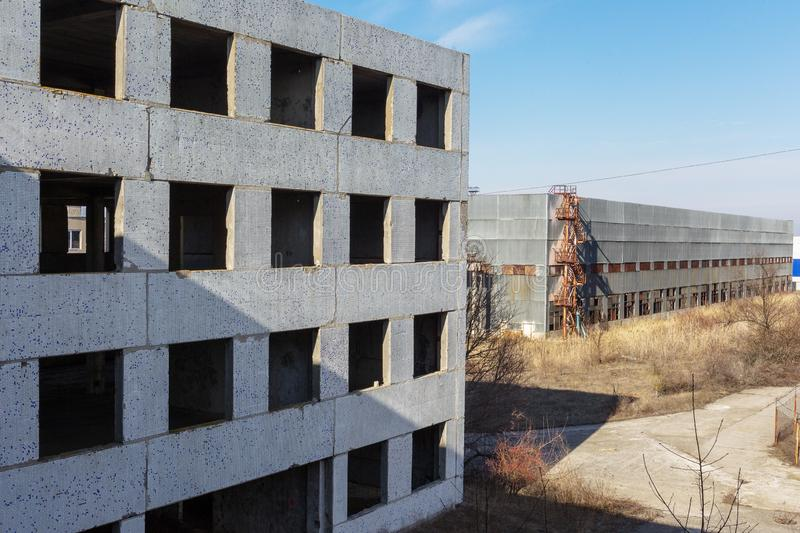 Corps of an old abandoned industrial plant. Abandoned construction of a nuclear power plant in Odessa, Teplodar. Industrial royalty free stock image