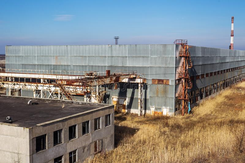 Corps of an old abandoned industrial plant. Abandoned construction of a nuclear power plant in Odessa, Teplodar. Industrial stock photography