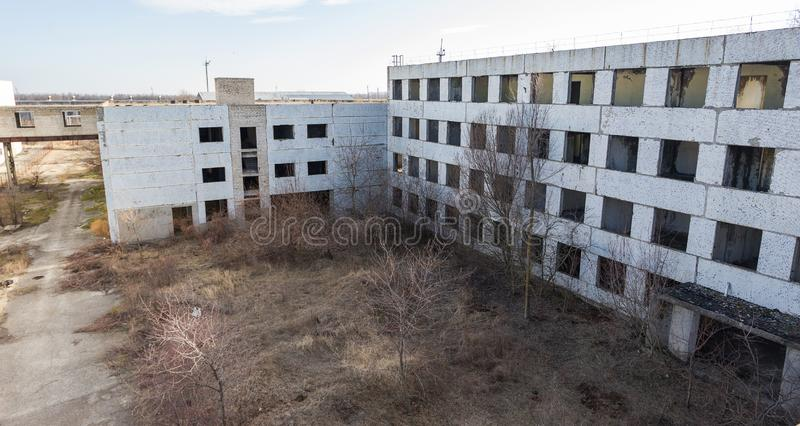 Corps of an old abandoned industrial plant. Abandoned construction of a nuclear power plant in Odessa, Teplodar. Industrial royalty free stock photos