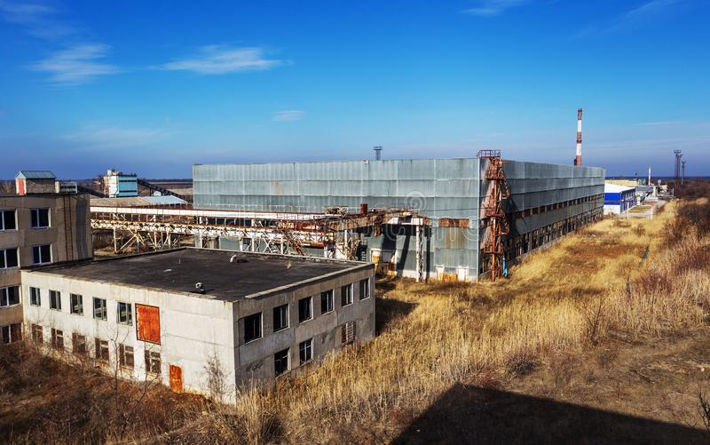 Corps of an old abandoned industrial plant. Abandoned construction of a nuclear power plant in Odessa, Teplodar. Industrial stock photos