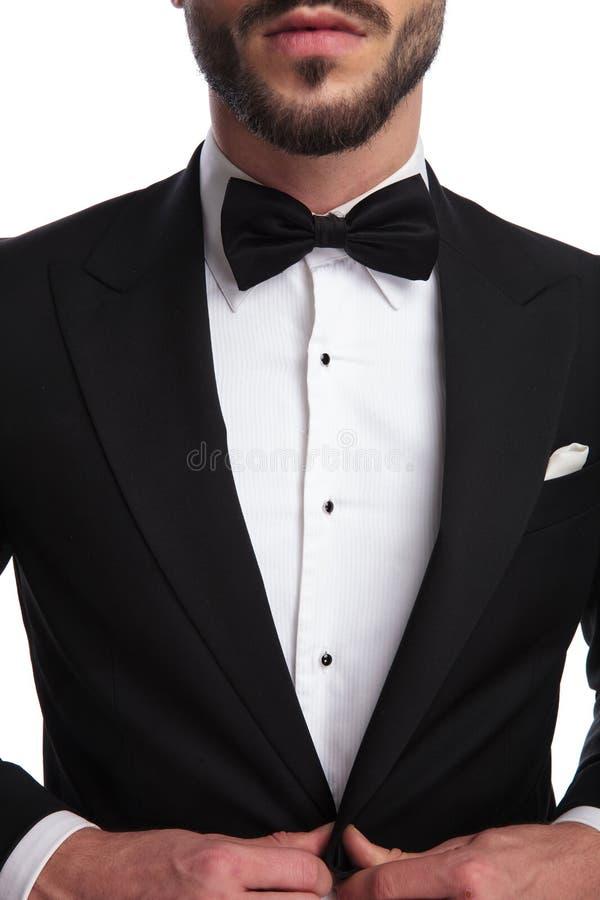 Corps supérieur d'un gantleman habillé par bien photographie stock