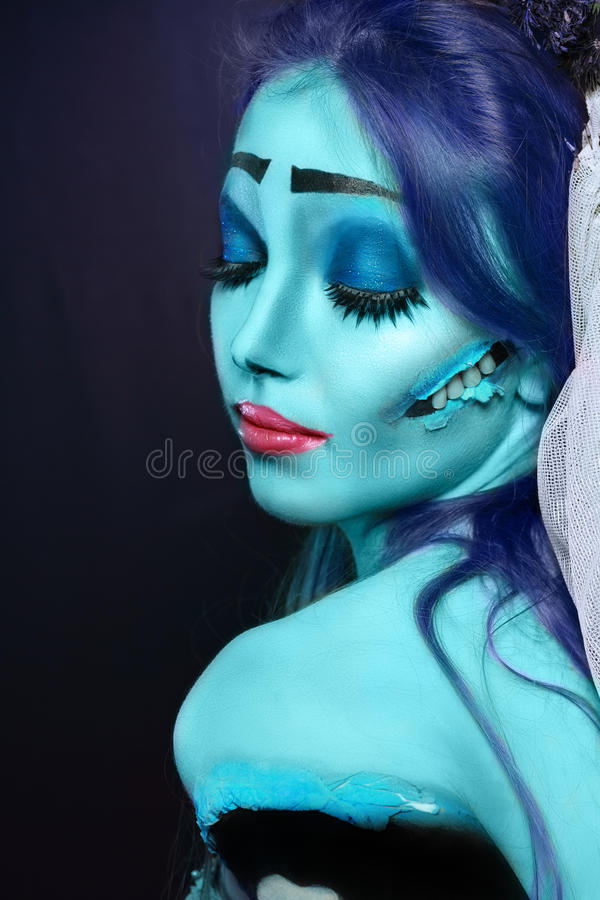 Corpse bride. Halloween: Sorrow scene of a corpse bride under blue moon light. Beautiful ghost zombie royalty free stock images