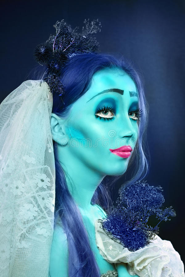 Corpse bride. Halloween: Sorrow scene of a corpse bride under blue moon light. Beautiful ghost zombie royalty free stock photo