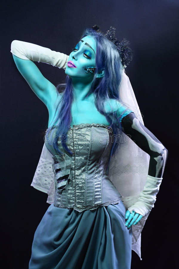 Corpse bride. Halloween: Sorrow scene of a corpse bride under blue moon light. Beautiful ghost zombie stock photography