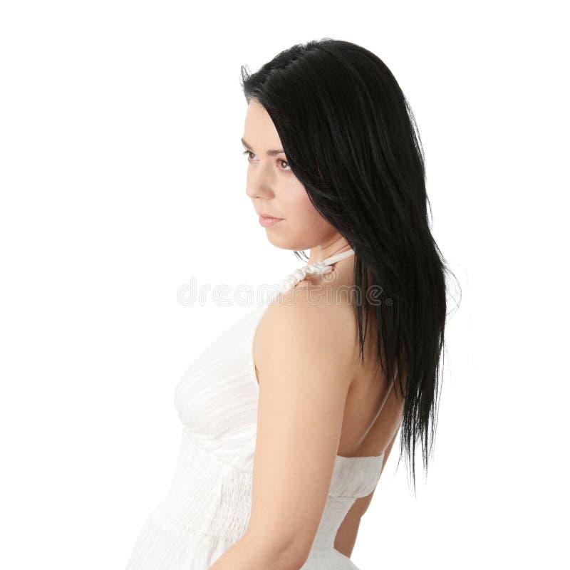 Corpulent female in elegant white dress stock images