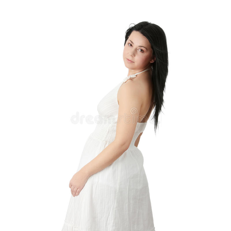 Corpulent Frau im eleganten weißen Kleid stockbild