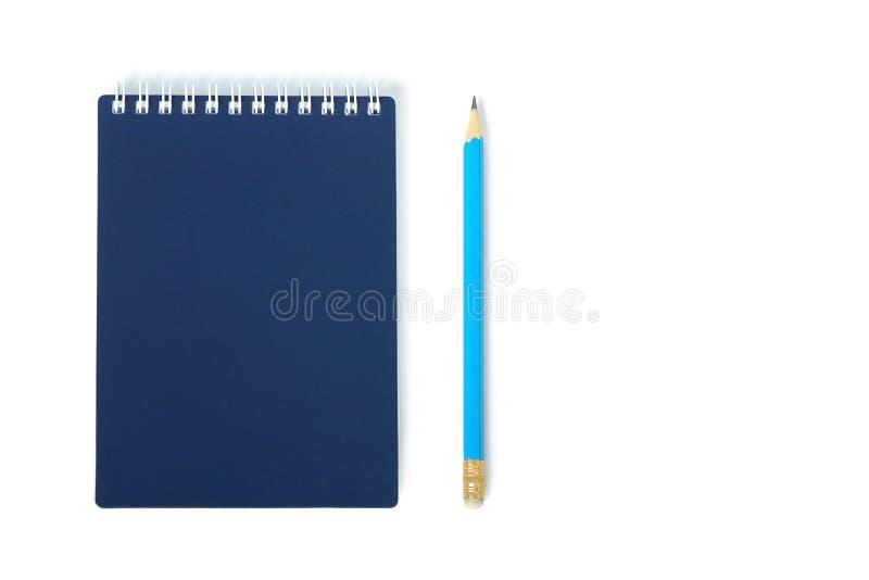 Corríjase con el cuaderno cerrado aislado imagen de archivo