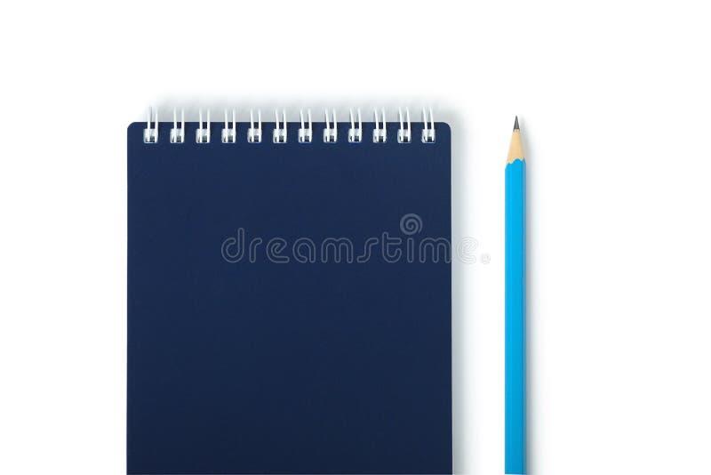 Corríjase con el cuaderno cerrado aislado fotos de archivo