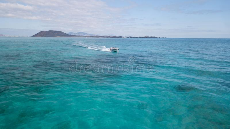Corralejo Fuerteventura: tourists visiting the lobos island with taxi service. 10.01.2017 Corralejo Fuerteventura: tourists visiting the lobos island with taxi royalty free stock images