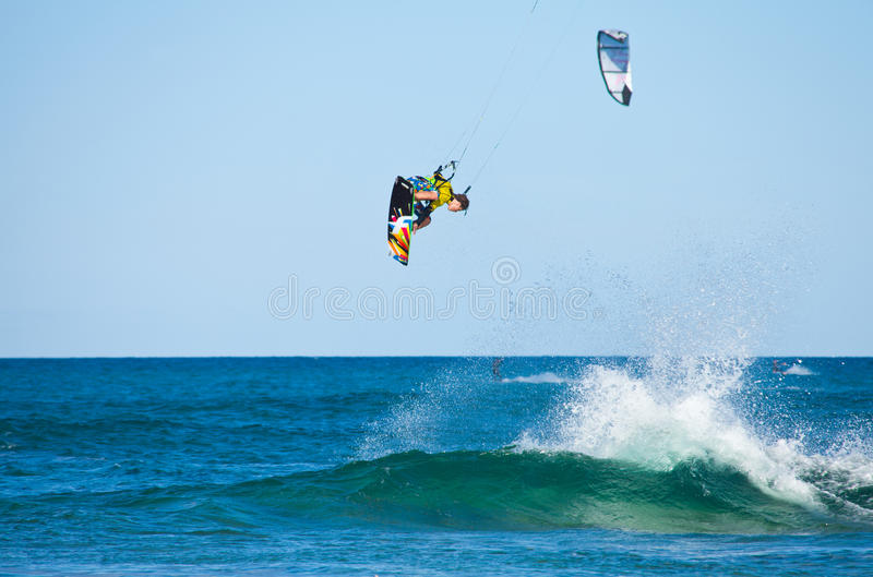 CORRALEJO, SPAIN - APRIL 28: Kitesurfer. Enjoys perfect wind and waves combination on 28 April 2012 in Corralejo, Fuerteventura, Spain stock photography