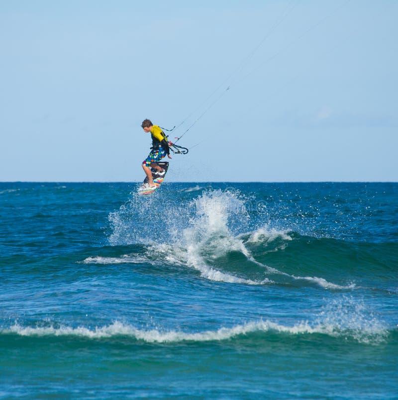CORRALEJO, SPAIN - APRIL 28: Kitesurfer. Enjoys perfect wind and waves combination on 28 April 2012 in Corralejo, Fuerteventura, Spain stock photos