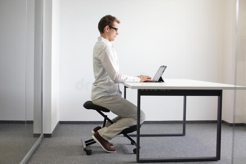 download correct sitting position on kneeling chair royalty free stock image image