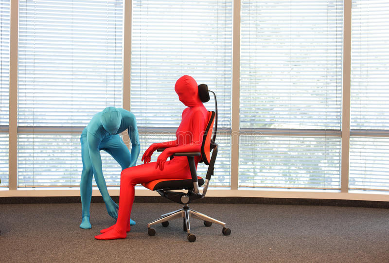 Correct sitting position on office armchair training royalty free stock photo