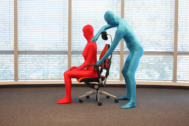 Correct sitting position on office armchair training royalty free stock photos