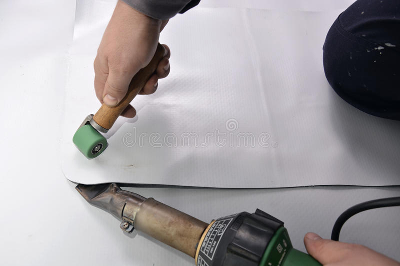 Correct welding with hand-welder, corner. Correct welding with hand-welder, heated air is blown between two pieces of membrane royalty free stock photography
