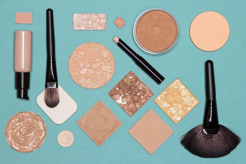 Corrective makeup flat lay set. Corrective makeup set, flat lay. Concealer stick, primer, liquid and cream foundation with correcting, bronzing, highlighting royalty free stock photos