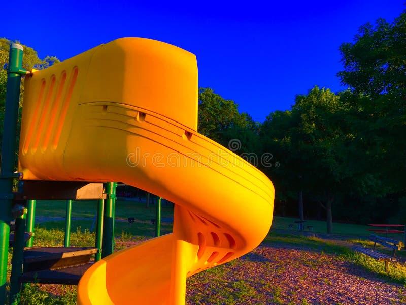 Corrediça amarela no por do sol fotos de stock royalty free