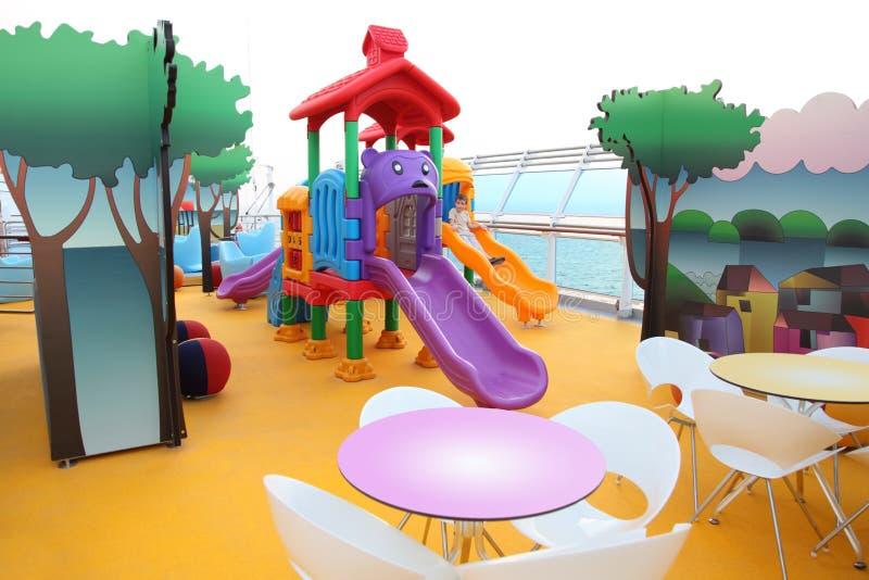 Corrediça Do Menino No Campo De Jogos Das Crianças Imagens de Stock Royalty Free
