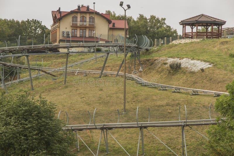 Corrediça gravitacional, corrida ao longo de um ano do toboggan na montagem St Anne, imagem de stock