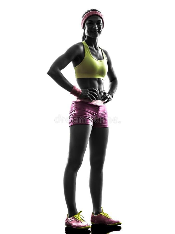 Corredor da mulher que exercita levantando a silhueta imagem de stock