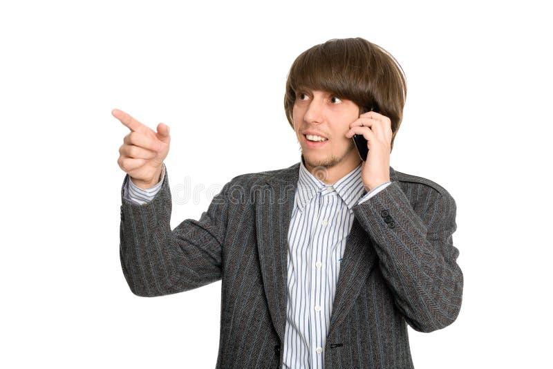 Corredor de bolsa que habla en un móvil fotos de archivo libres de regalías