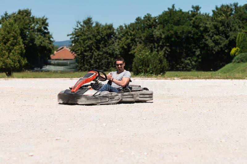 Corredor de Karting del hombre joven foto de archivo