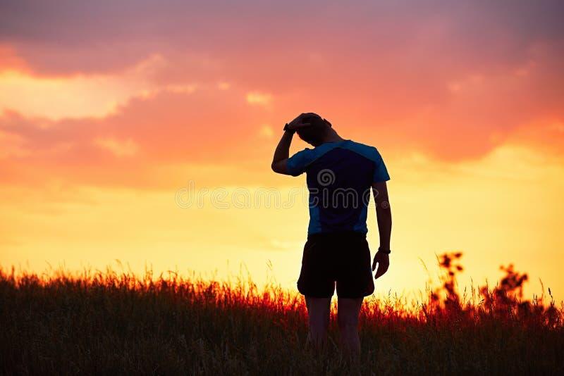 Corredor en la puesta del sol fotos de archivo