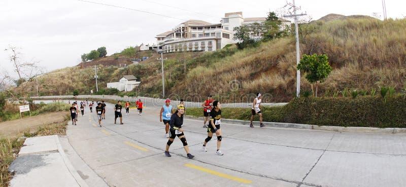 Corredores da fuga da maratona foto de stock