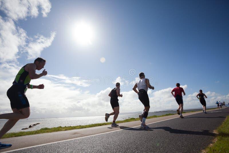 Corredores, triathlon imagen de archivo libre de regalías