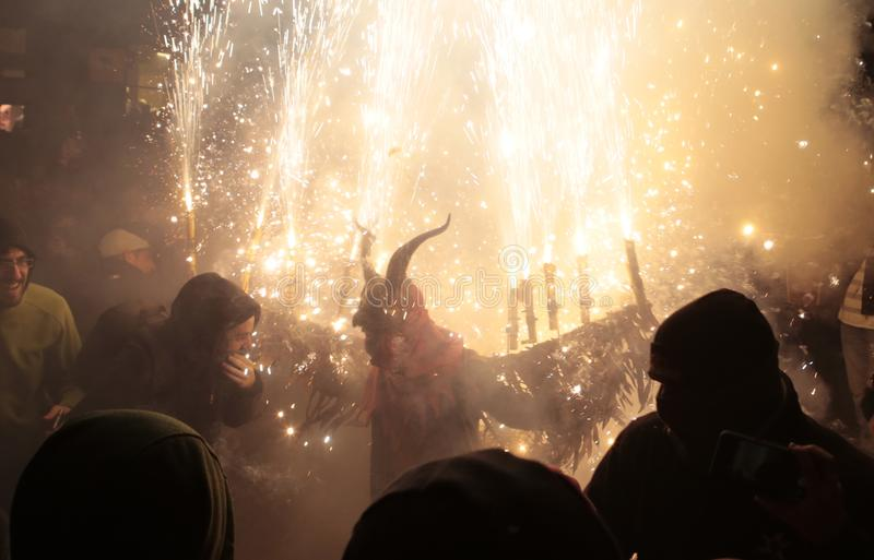 Correfoc in palma during saint sebastian local patron festivities. Palma de Mallorca, Spain, January 21st, 2018. Revellers dressed as devils and holding royalty free stock image